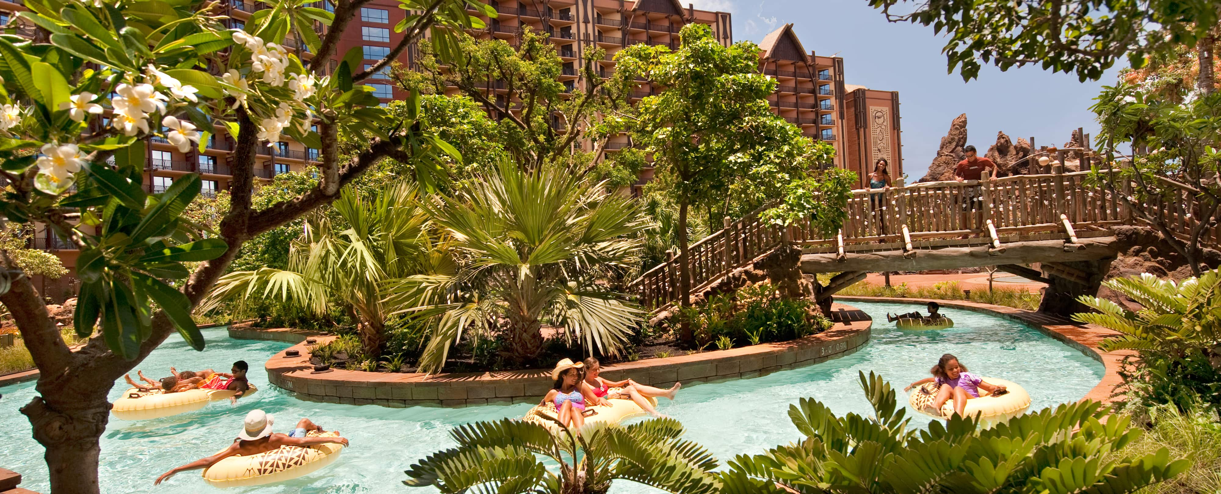 Girls float on the lazy river in the Aulani pool area