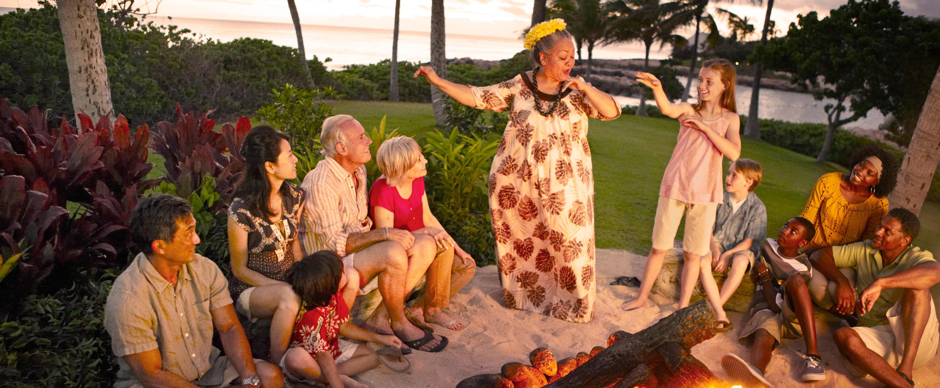 Aunty teaches dance moves during a fireside storytelling activity