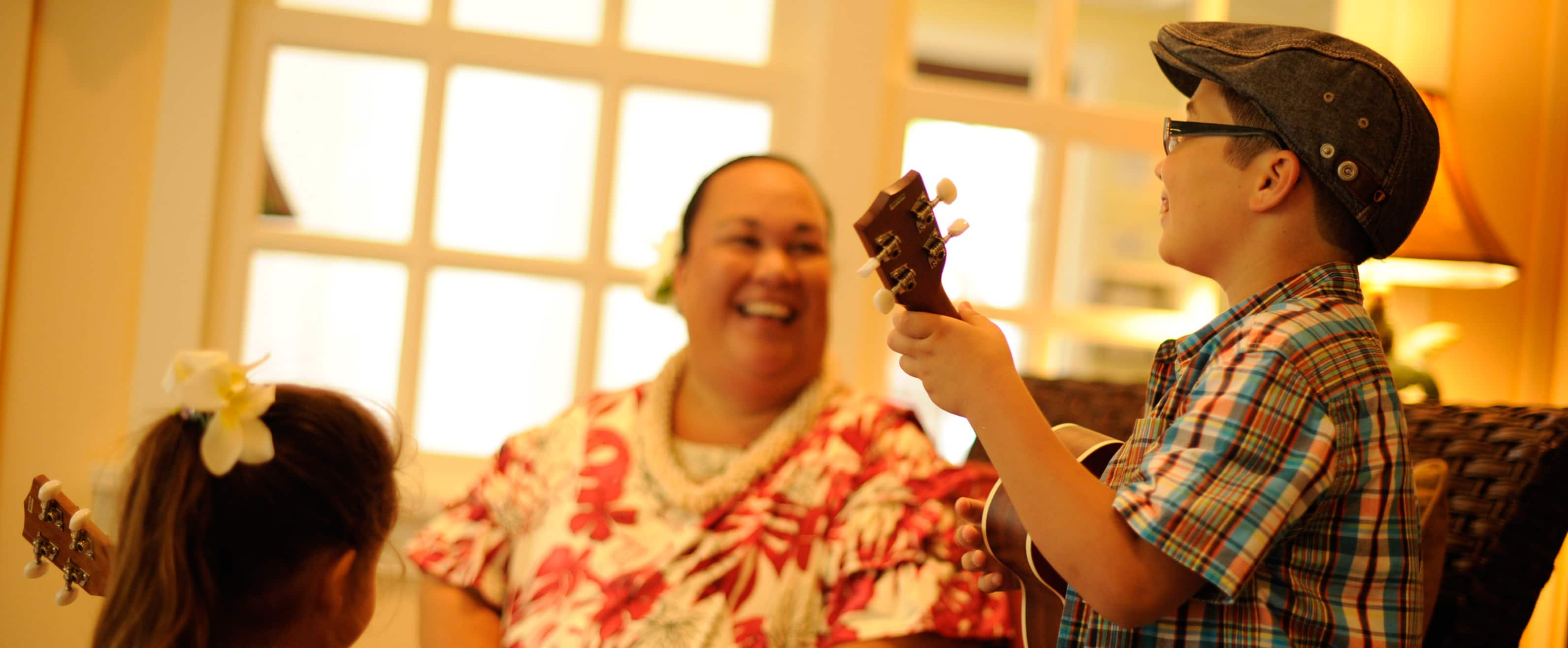 Kids playing Hawaiian instruments at Aunty's Beach House