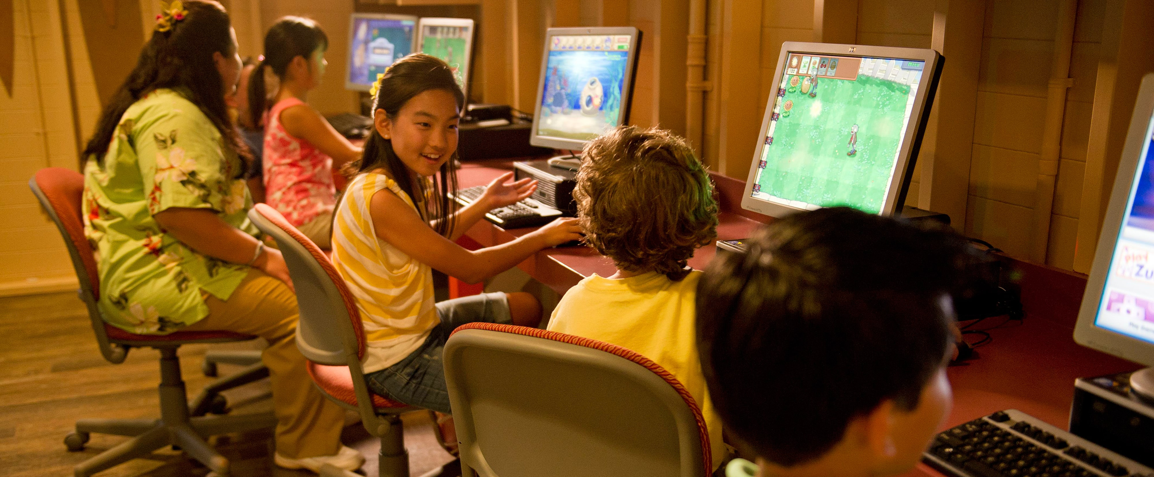 Kids playing computer games at Aunty's Beach House