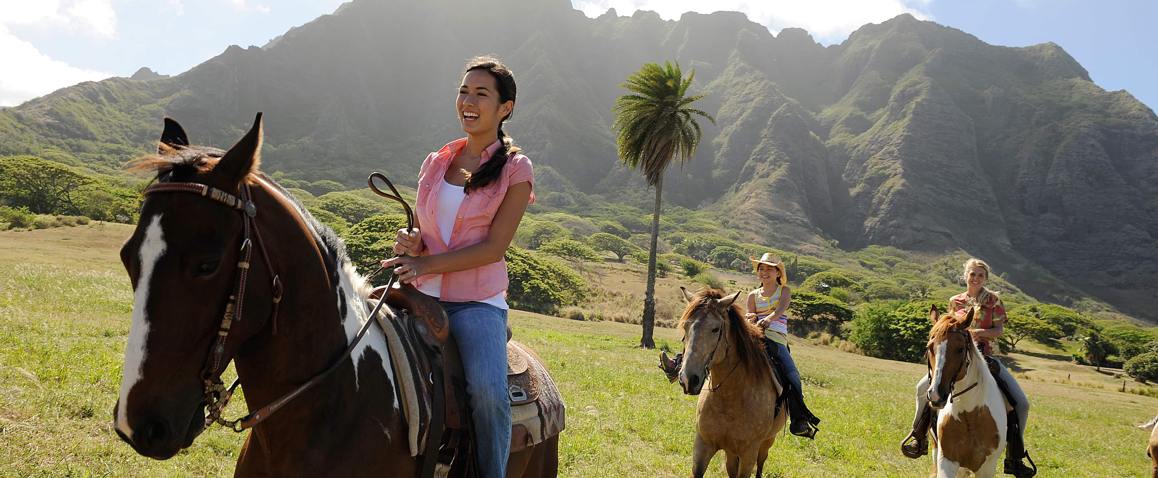 People riding horses in the Oʻahu countryside