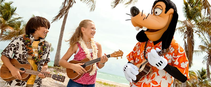 2 kids play ukuleles with Goofy by the beach at Aulani