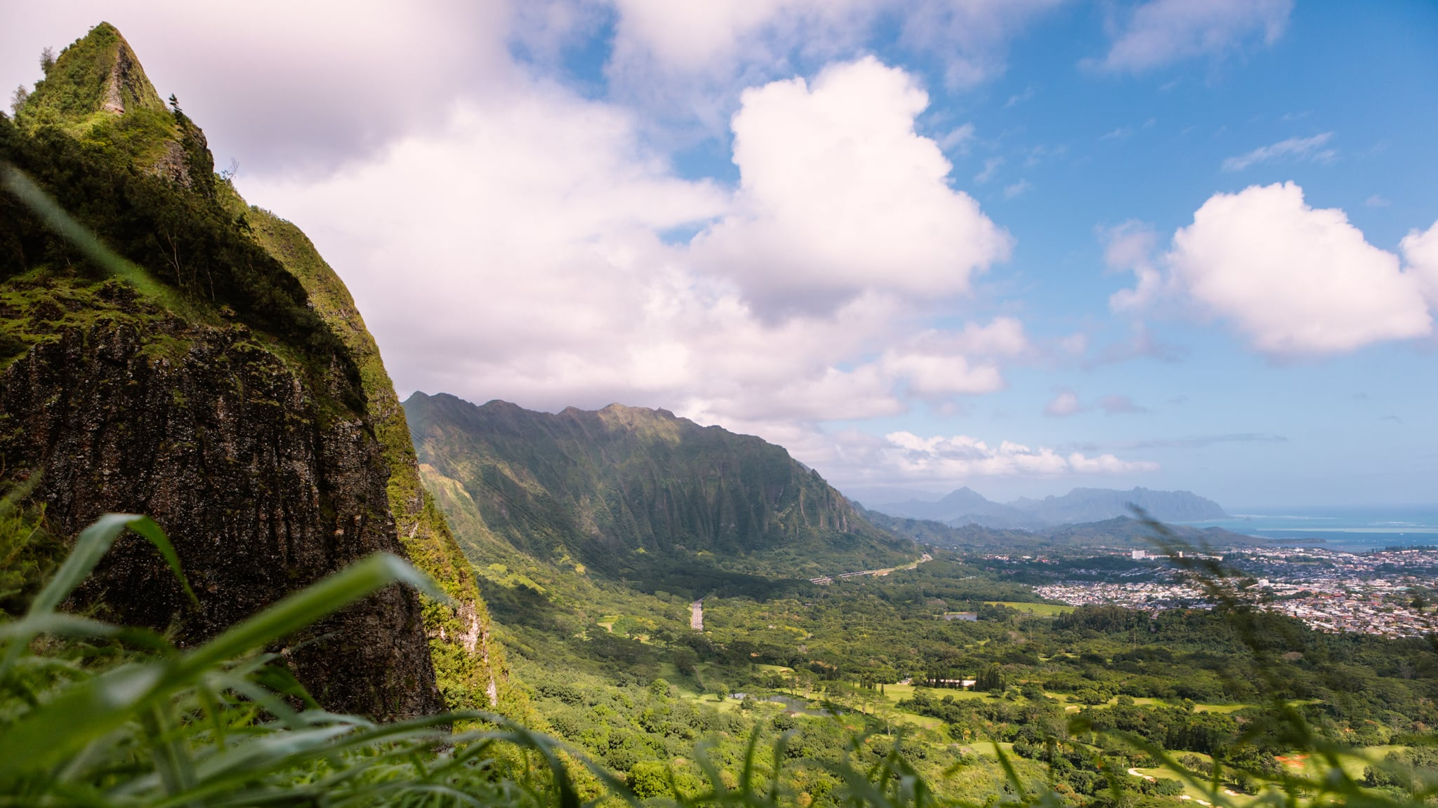 Tropical forests on mountains overseeing a lush valley