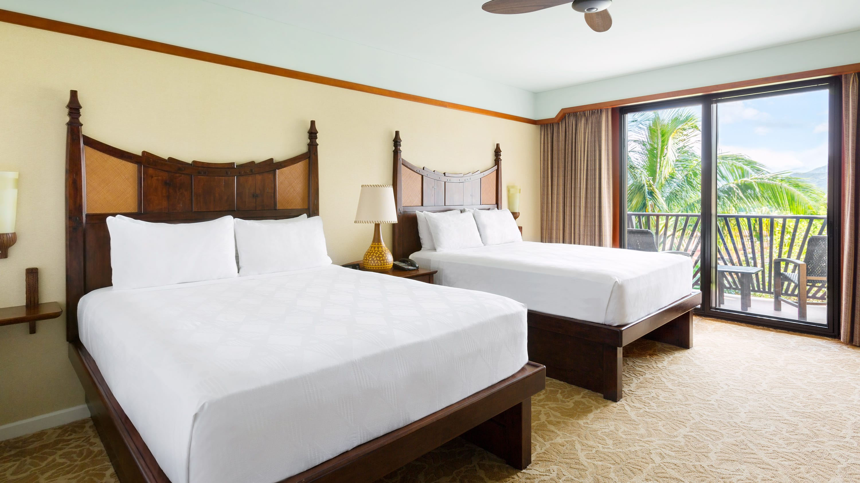 A standard room at Aulani Resort with 2 queen beds