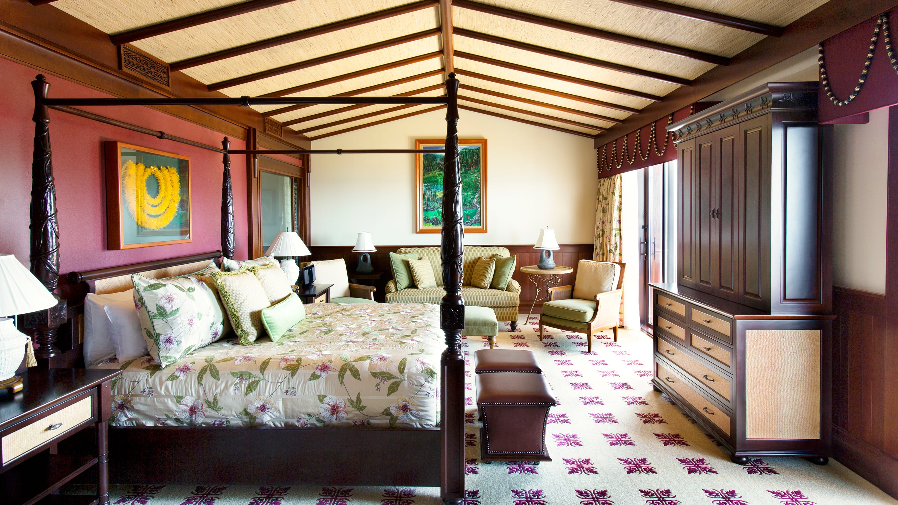 A room with a four poster bed, 4 lamps, 2 chairs, a couch and an armoire
