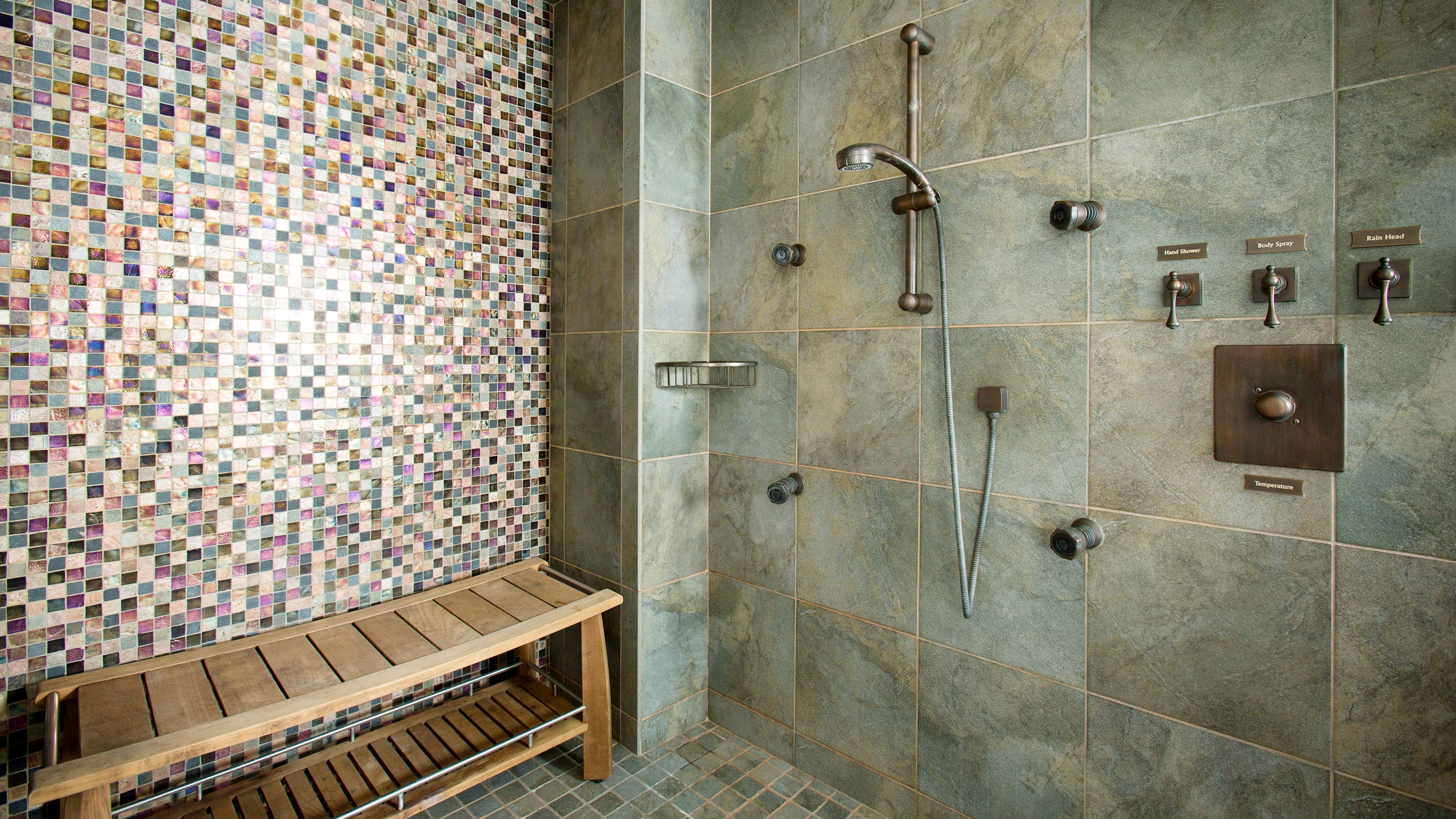A shower with a bench