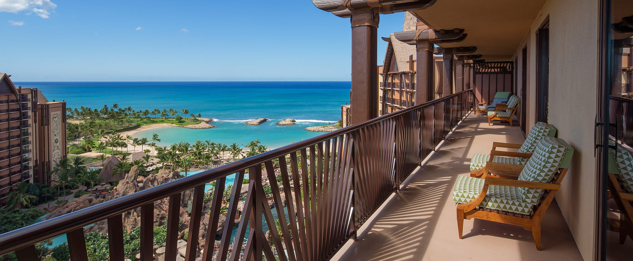 A long balcony at the Aulani features comfortable seating and overlooks the beach and ocean
