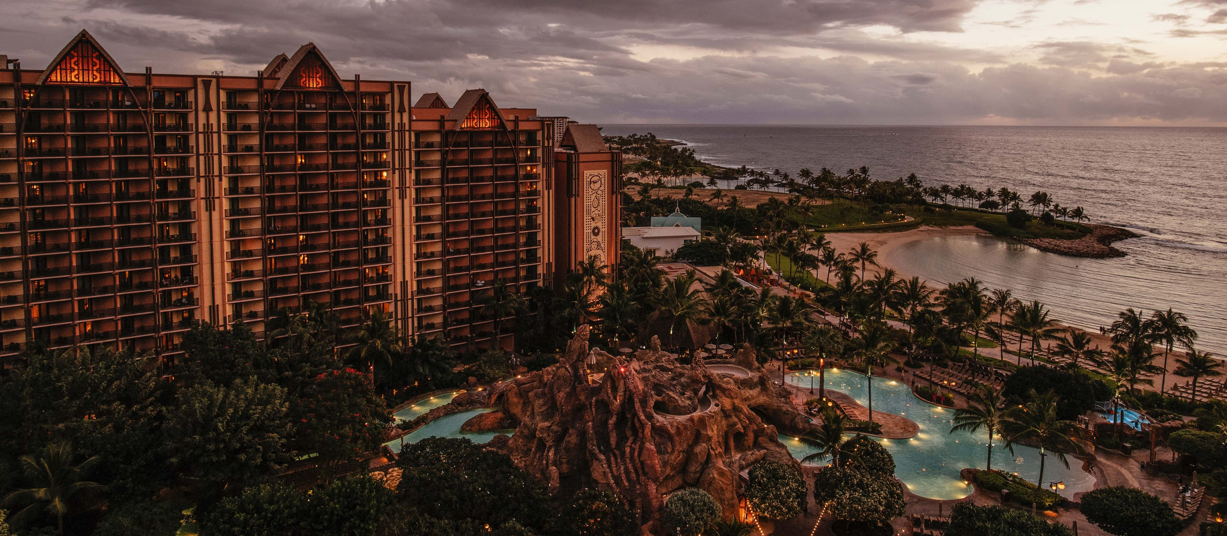 Dark clouds loom over the hotel, pools and lagoon of Aulani Resort