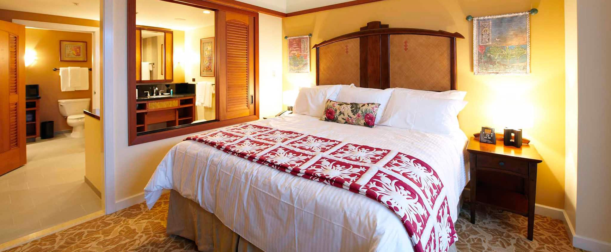 the 1 bedroom villa features crisp linens warm wood accents and a large bathroom - One Bedroom