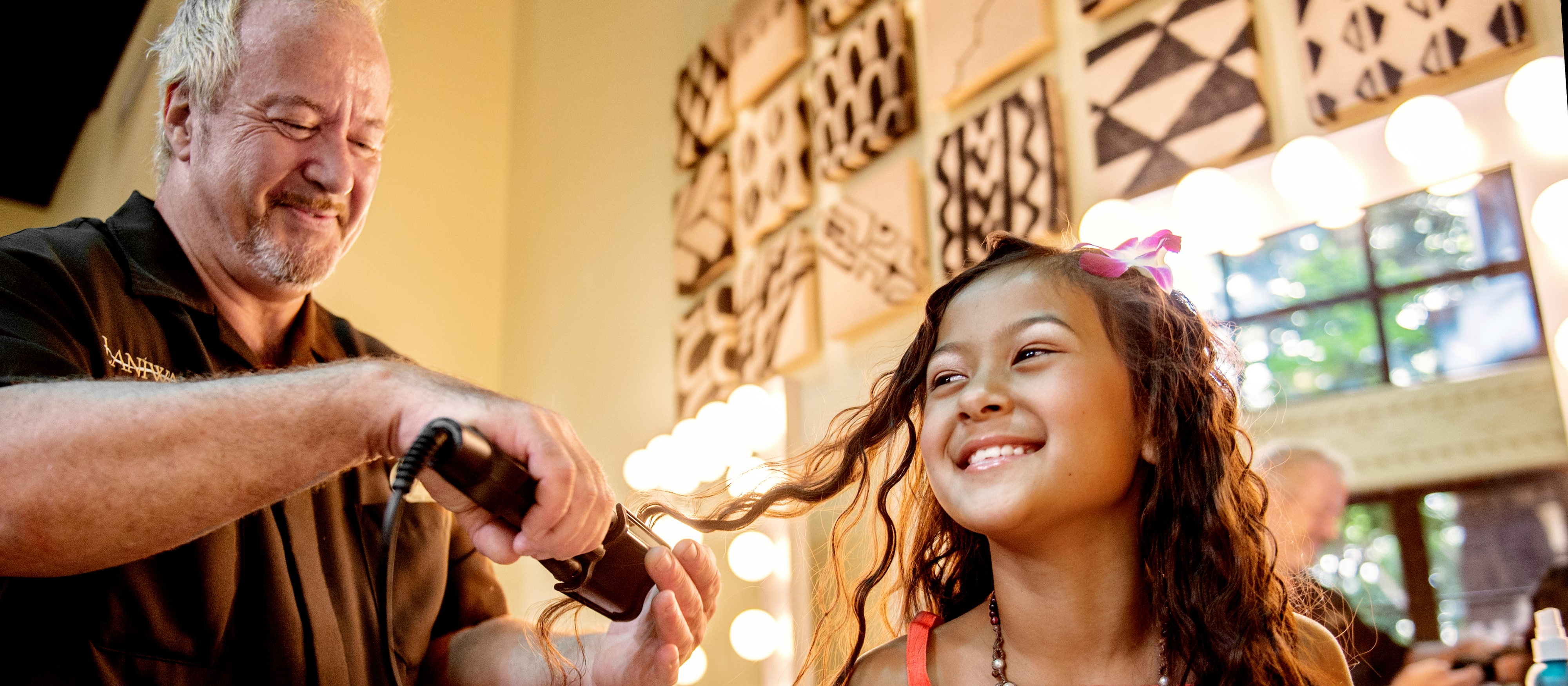 A young girl gets a Moana makeover by a Painted Sky HI Stylist