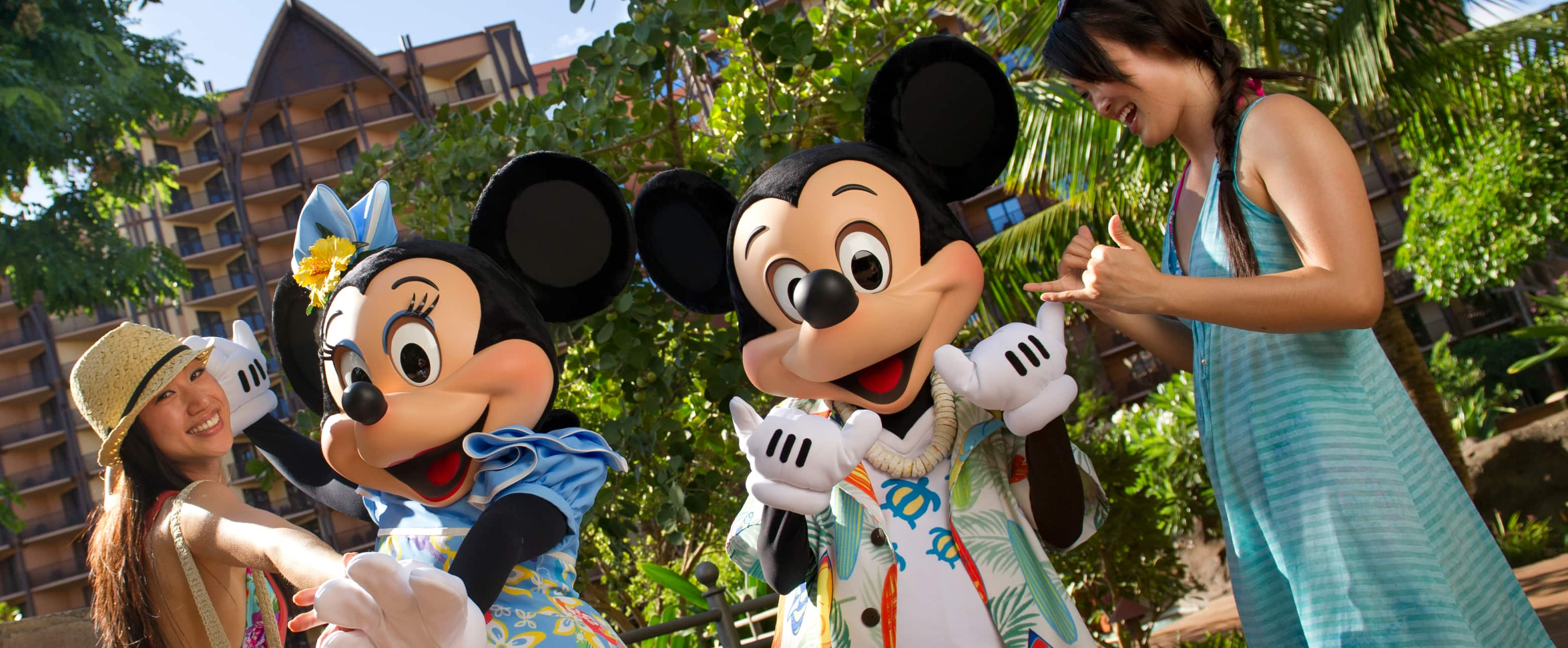A mother and daughter with Minnie and Mickey Mouse at Aulani