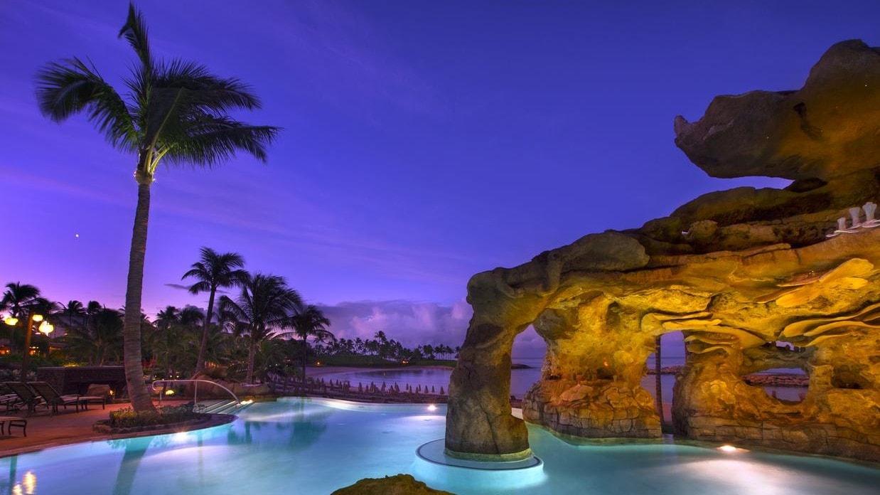 The Ka Maka Grotto pool area, illuminated at night