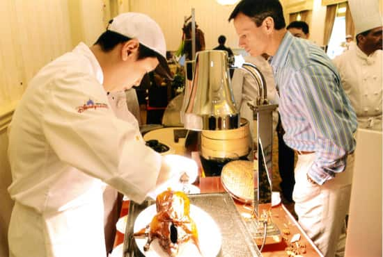 Tom Staggs samples the excellent Peking Roast Duck at Hong Kong Disneyland.