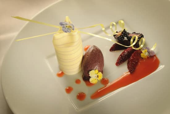 White Chocolate and Meyer Lemon Purse with Blackberry-Violet Sherbet, to be Served at Remy