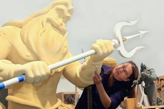 Disney Imagineer Joni Van Buren sculpts a model of King Triton, who, in his final form will be 35 feet tall and tower over guests at Walt Disney Parks and Resorts newest Resort. Disney's Art of Animation Resort will be one-of-a-kind, with themed building exteriors and room interiors that bring to life The Lion King, Cars, Finding Nemo and The Little Mermaid. Disney's Art of Animation Resort is expected to open by the end of 2012.