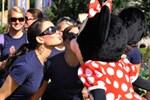 Miss Alabama 2010 Ashley Davis (left), of Dothan, Ala., gives Minnie Mouse a kiss at the Magic Kingdom.
