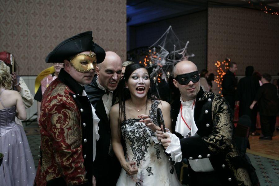 Bride and Groom in Costume Enjoying the Festivities