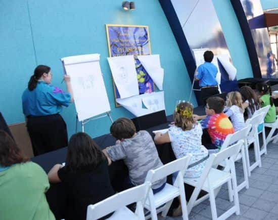 Disney Quest Teaching Guests How to Illustrate a Disney Character