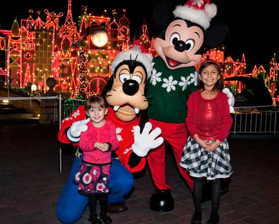 Adela Jauregui, 8, a Patient at CHOC Children's, and her sister with Mickey Mouse and Goofy