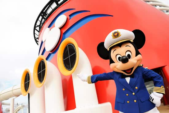Mickey Mouse welcomes guests aboard the maiden voyage of the Disney Dream