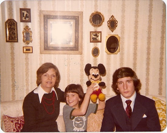 Kelly Glassburn Proudly Holding Up Her First Mickey Mouse Plush