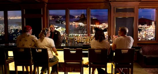 Adult guests sip on signature cocktails in Skyline, aboard the Disney Dream
