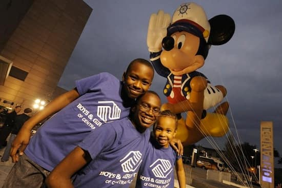 Boys & Girls Clubs Children Lorenzo White (13), Germaine Childs (9) and Tyasia Childs (6) Posed with the Giant Sailor Mickey Mouse Balloon