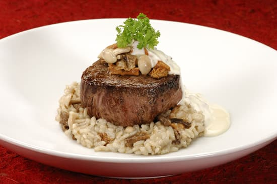 Filet Mignon with Wild Mushroom Risotto and White Truffle Butter Sauce
