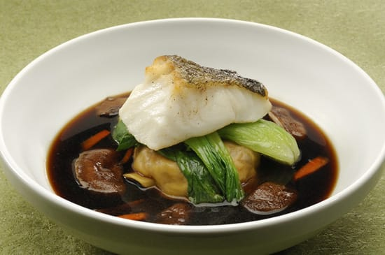 Seared 'Gooseberry' Cod with Braised Oxtail Ravioli, Shiitake Mushrooms, Bok Choy and Consommé