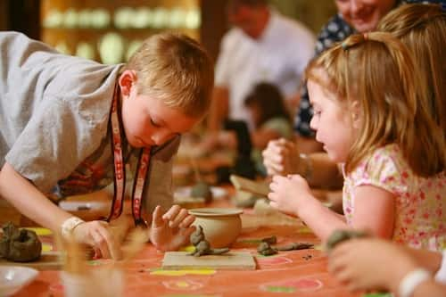 Young travelers can paint clay to make a special keepsake from their experience in Palermo