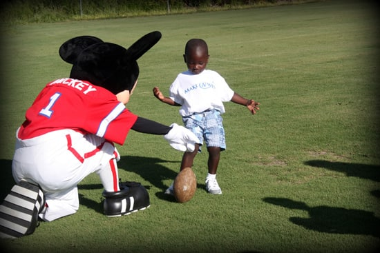 Playing Football with Mickey Mouse