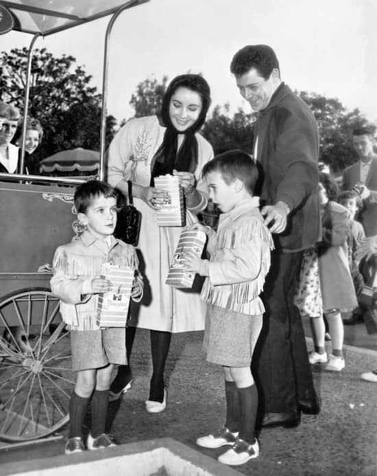 Elizabeth Taylor at Disneyland Park in 1962 with Eddie Fisher and her sons Michael and Christopher