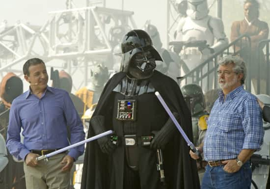 Walt Disney Co. president and CEO Bob Iger (left) and 'Star Wars' creator George Lucas (right) join 'Star Wars' villain Darth Vader (center) May 20, 2011 at Disney's Hollywood Studios theme park in Lake Buena Vista, Fla. during grand opening ceremonies for 'Star Tours -- The Adventures Continue,' a new 3-D attraction based on the 'Star Wars' films. The attraction, which features more than 50 possible random ride experiences, opened May 20, 2011 at Walt Disney World in Florida and will open June 3, 2011 at Disneyland Resort in California. (Kent Phillips, photographer)