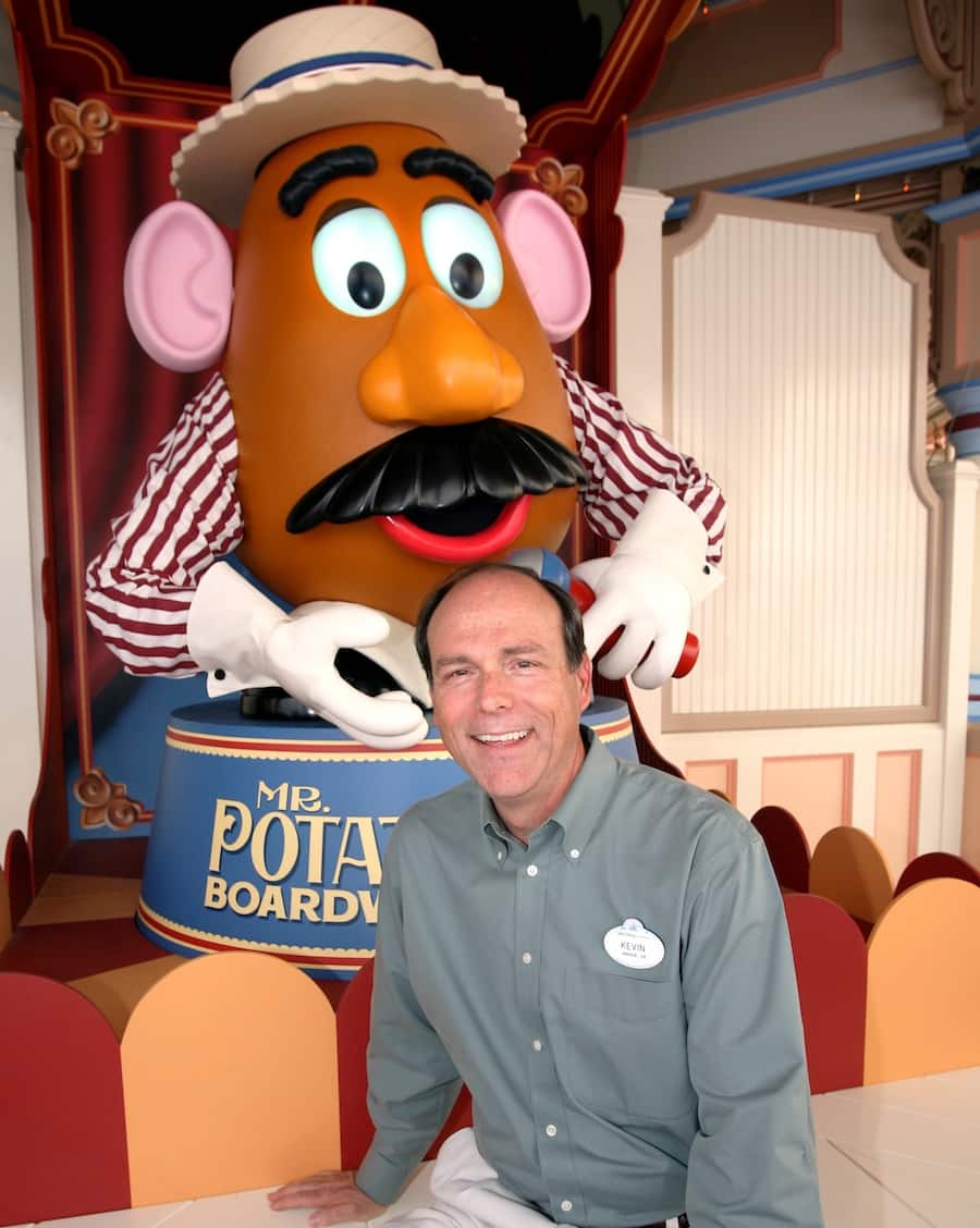 Kevin Rafferty in front of Mr. Potato head from Disney California Adventure's Toy Story Midway Mania!