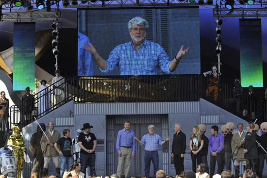Walt Disney Co. president and CEO Bob Iger (left) and 'Star Wars' creator George Lucas at Disney's Hollywood Studios theme park in Lake Buena Vista, Fla. May 20, 2011 during grand opening ceremonies for 'Star Tours -- The Adventures Continue,' a new 3-D attraction based on the 'Star Wars' films.