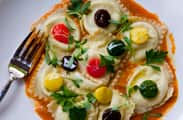 And for vegetarians, goat cheese ravioli with local baby vegetables on top.