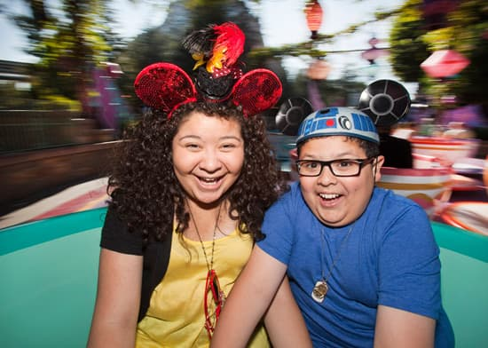 Rico Rodriguez of the ABC Comedy 'Modern Family' and his Sister Raini Rodriguez Take a Spin on The Mad Tea Party at Disneyland Park