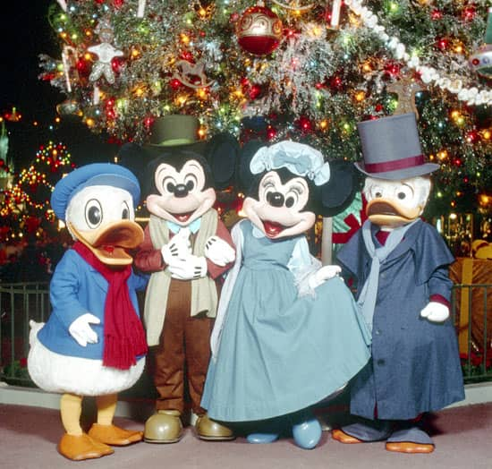 Donald, Mickey Mouse, Minnie Mouse and Scrooge McDuck Make Appearances at Magic Kingdom Park Dressed as Bob Cratchit, Mrs. Cratchit, Nephew Fred and Ebenezer Scrooge in December 1993