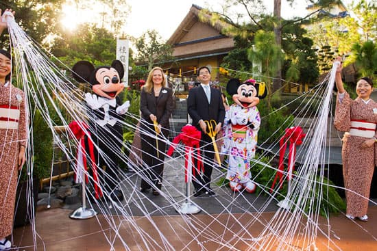 Mickey and Minnie; Erin Youngs, Vice President of Epcot; and Hideaki Morooka, General Manager International Business Operations for Isetan Mitsukoshi Holdings Ltd. at the Official Debut of Katsura Grill at Epcot's Japan Pavilion