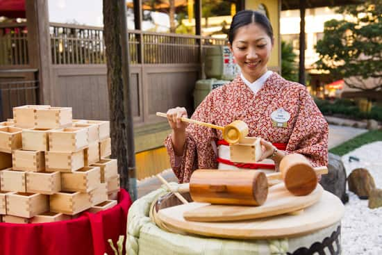 Sake Being Served in a Ceremonial Cedar Cup for the Opening of Katsura Grill at Epcot