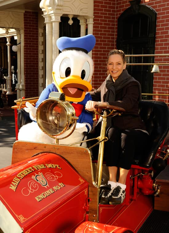 Award-Winning Actress Uma Thurman Poses with Donald Duck in the Famed 'Engine #71' Fire Engine on Main Street, U.S.A., at Magic Kingdom Park