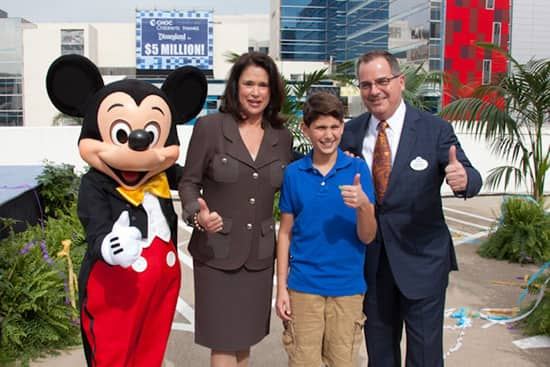 From left, Mickey Mouse, CHOC Children's President and CEO Kim Cripe, 14-year-old CHOC patient Tommy Conforti and Disneyland Resort President George A. Kalogridis.