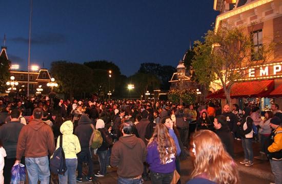 Guests Walking Down Main Street, U.S.A. in Disneyland Park