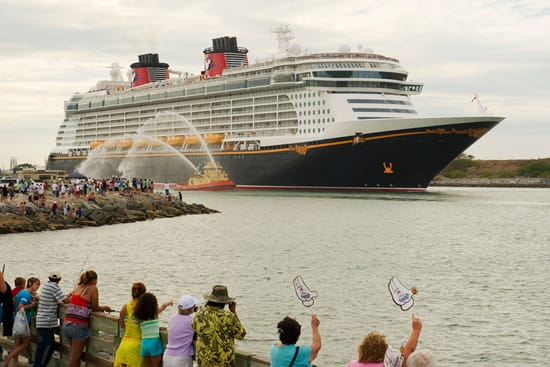 The Disney Fantasy sailing by approximately 4,500 spectators, who were waving Mickey hands along the shoreline.