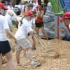 Volunteers shoveled mulch onto the playground as one of the final tasks of the day.
