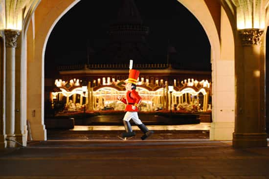 A Hopeful Toy Soldier Practices for Mickey's Once Upon A Christmastime Parade at Magic Kingdom Park