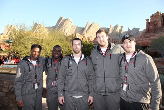 Players from the Wisconsin Badgers pose at Cars Land in Disney California Adventure park