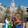 'Who Wants to Be a Millionaire?' host Meredith Vieira (center) poses December 5, 2012 with Disney characters Belle and Beast during the grand opening celebration for New Fantasyland in the Magic Kingdom park in Lake Buena Vista, Fla.  A two-time Daytime Emmy Award-winner for her work on 'Millionaire,' Vieira is one of the celebrities attending the Grand Opening of New Fantasyland at Walt Disney World Resort.