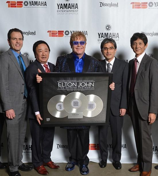 Yamaha Executives Present Elton John With a Special Gift