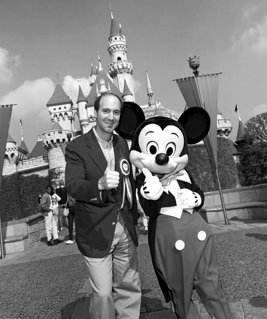 Gene Siskel Meets Up With Mickey Mouse at Sleeping Beauty Castle in February of 1989